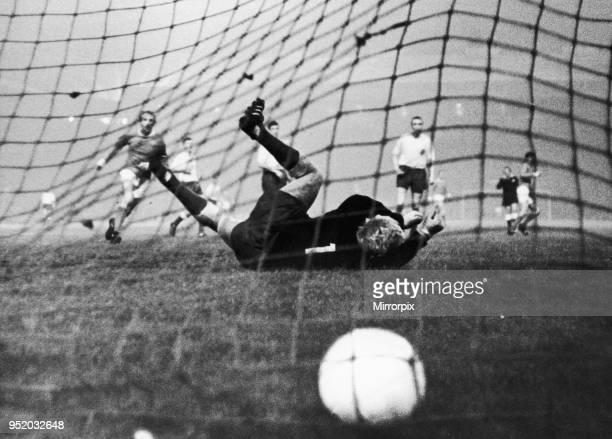 Manchester United v HJK Helsinki. HJK keeper dives and misses the ball as Denis Law looks on during Uniteds 6-0 victory over Helsinki in the European...