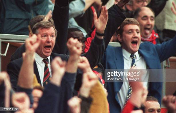 Manchester United manager Alex Ferguson celebrates with injured team captain Steve Bruce after his sides 50 victory over Nottingham Forest at Old...