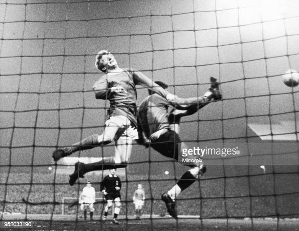 Manchester United v Partizan Belgrade European Cup Semi Final second leg High flying Denis Law collides with Partizan goalkeeper Milutin Soskic in a...