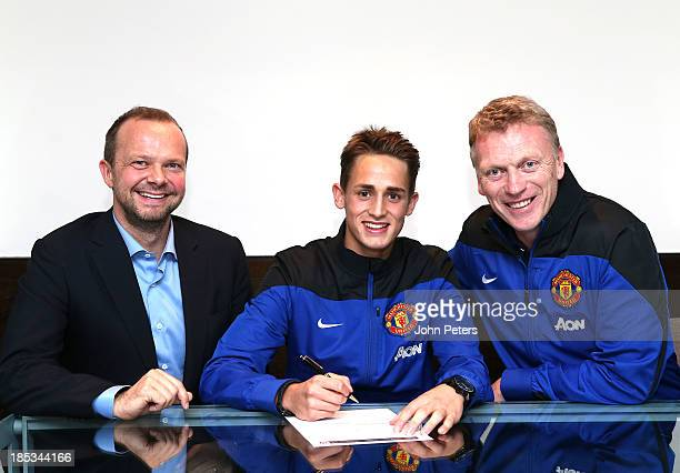 Manchester United Vice Chairman Ed Woodward, Adnan Januzaj and Manager David Moyes pose as Januzaj signs a five year contract with the club at The...