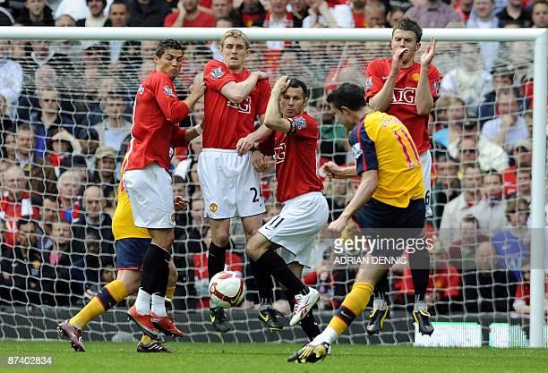 Manchester United wall of Cristiano Ronaldo Darren Fletcher Ryan Giggs and Michael Carrick react to block Arsenal's Dutch forward Robin Van Persie's...