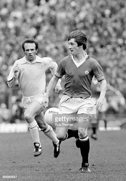 Manchester United winger Gordon Hill is chased by Leeds United defender Paul Reaney during the FA Cup SemiFinal at Hillsborough in Sheffield 23rd...
