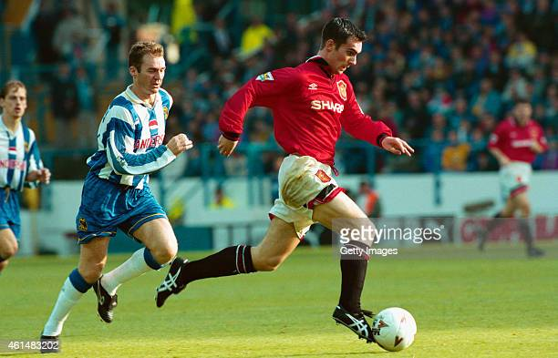 Manchester United winger Keith Gillespie races away from John Sheridan of Sheffield Wednesday during an FA Premiership match between Sheffield...