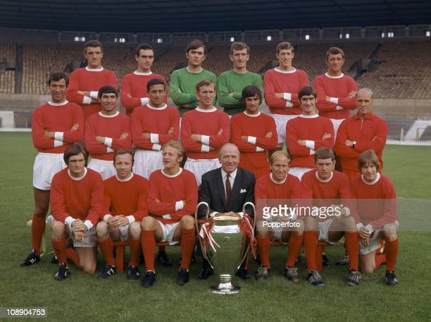 Manchester United with the European Cup at Old Trafford, Manchester, July 1968. Back row, left to right: Bill Foulkes, John Aston, Jimmy Rimmer, Alex...