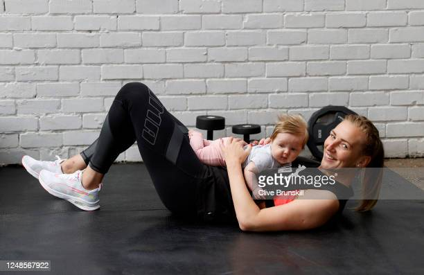 Manchester United Women and England goalkeeper Siobhan Chamberlain with her baby daughter Emilia during a break from her training session at home on...