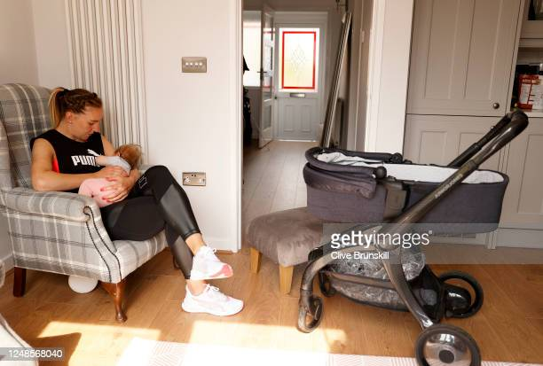 Manchester United Women and England goalkeeper Siobhan Chamberlain feeds her baby daughter Emilia during a break from her training session at home on...