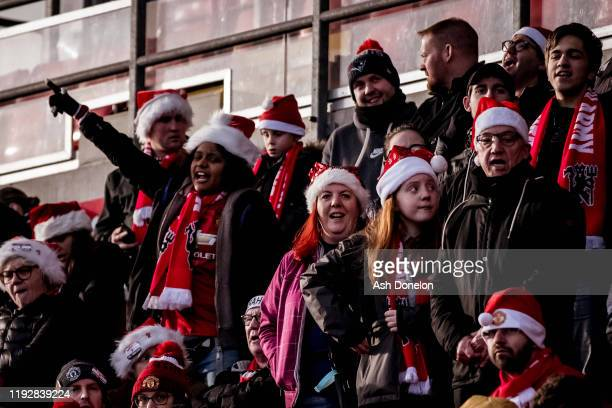 Manchester United Women fans watch from the stand ahead of the Barclays FA Women's Super League match between Manchester United and Everton at Leigh...