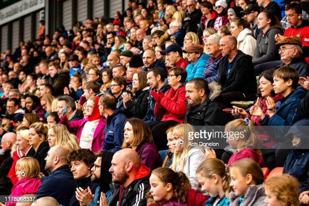 Manchester United Women fans watch from the stand during the Barclays FA Women's Super League match between Manchester United and Liverpool at Leigh...
