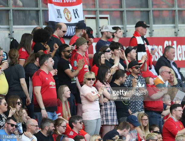 Manchester United Women fans watch from the stand during the WSL match between Manchester United Women and Crystal Palace Women at Leigh Sports...