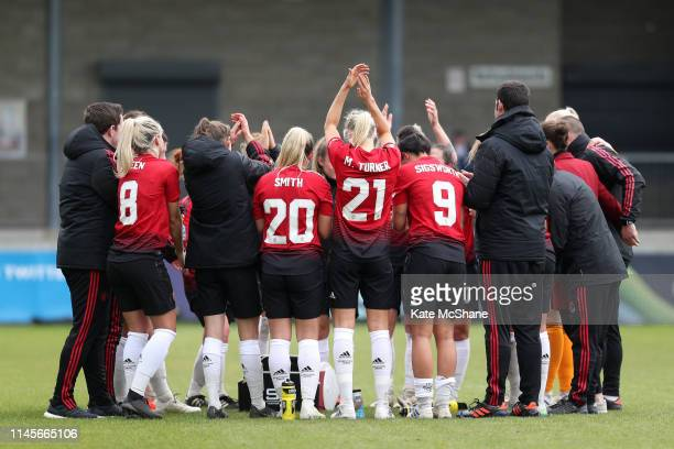 Manchester United Women players and staff celebrate following their victory in the FA Women's Championship match between Millwall Lionesses and...