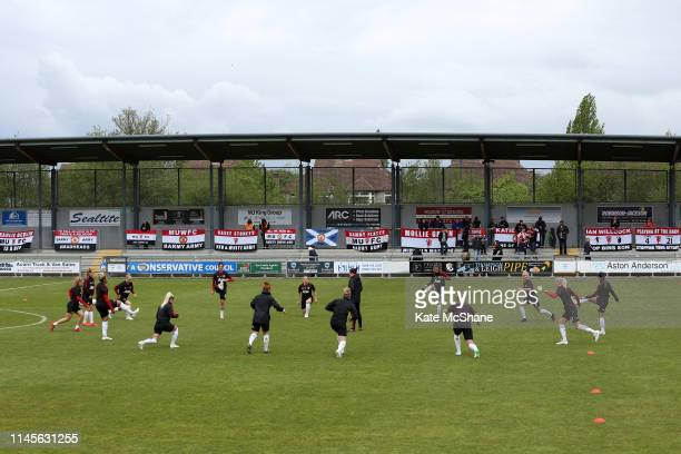 Manchester United Women warm up as fans show banners of support ahead of the FA Women's Championship match between Millwall Lionesses and Manchester...
