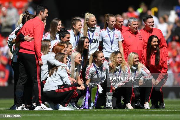 Manchester United Women's players pose for a photograph after winning the FA Women's Championship prior to the Premier League match between...
