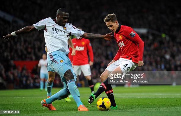 Manchester United's Adnan Januzaj and West Ham United's Guy Demel battle for the ball