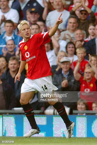 Manchester United's Alan Smith celebrates his goal against Norwich 21 August 2004 during today's Premiership football clash at Old Trafford...
