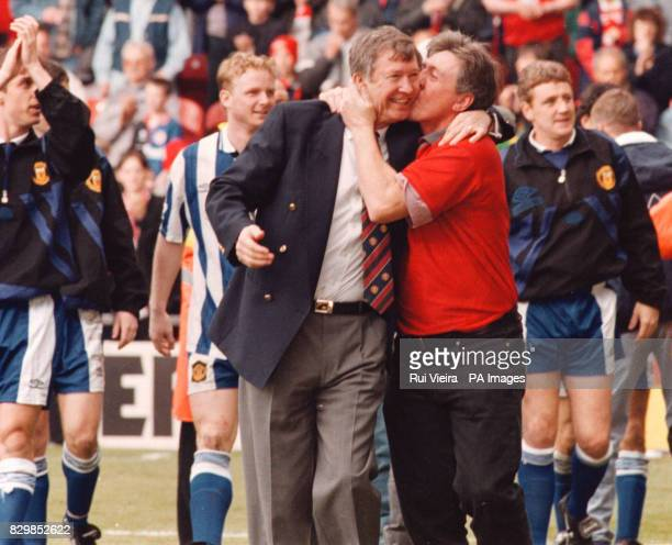 Manchester United's Alex Ferguson is given a kiss by a fan as his triumphant team parade round the pitch at Middlesbrough today after winning the FA...