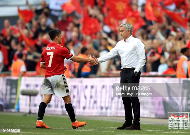 Manchester United's Alexis Sanchez and manager Jose Mourinho during the Emirates FA Cup semifinal match at Wembley Stadium London