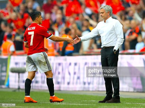 Manchester United's Alexis Sanchez and Manchester United manager Jose Mourinho shake hands