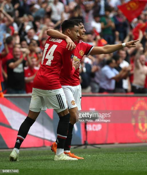 Manchester United's Alexis Sanchez celebrates scoring his side's first goal of the game with team mate Jesse Lingard during the Emirates FA Cup...