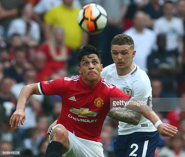Manchester United's Alexis Sanchez holds of Tottenham Hotspur's Kieran Trippier during the FA Cup semifinal match between Tottenham Hotspur and...