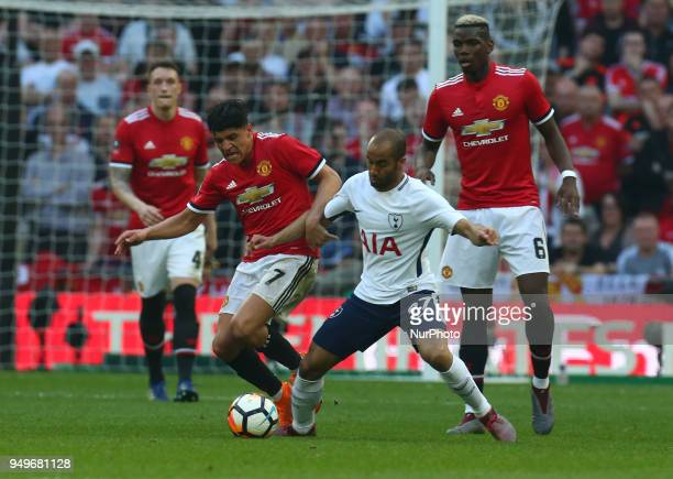 Manchester United's Alexis Sanchez holds of Tottenham Hotspur's Lucas Moura during the FA Cup semifinal match between Tottenham Hotspur and...