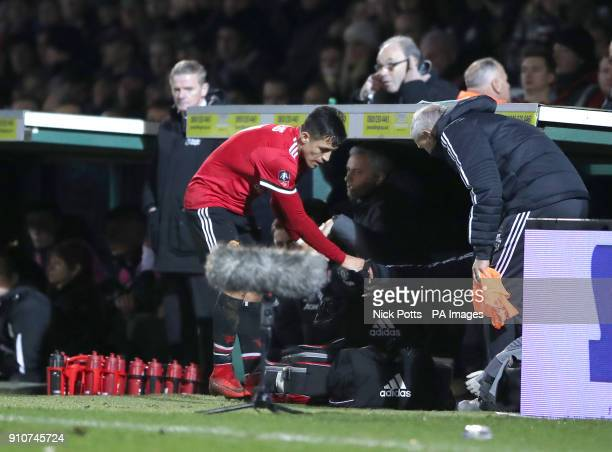 Manchester United's Alexis Sanchez in the dugout as Manchester United manager Jose Mourinho looks on during the Emirates FA Cup fourth round match at...