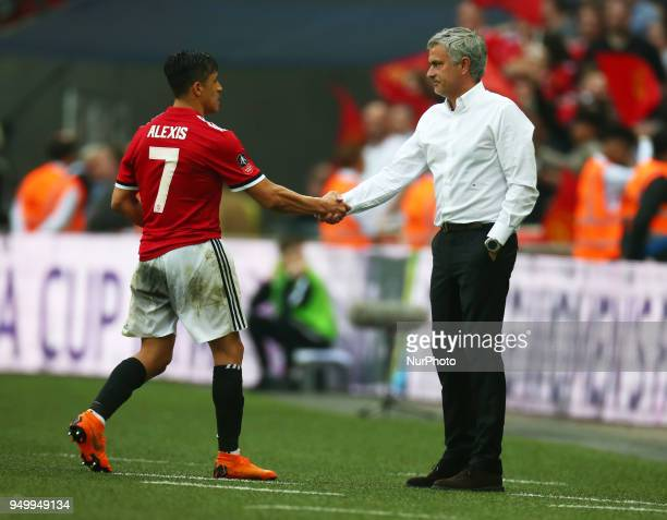 Manchester United's Alexis Sanchez shanks hands with Manchester United manager Jose Mourinho during the FA Cup semifinal match between Tottenham...