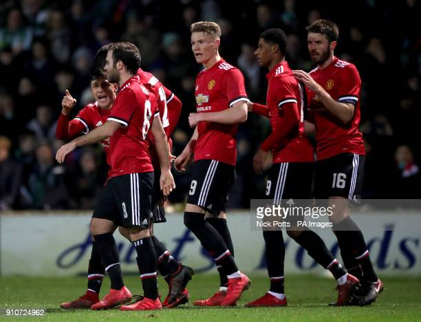 Manchester United's Alexis Sanchez speaks with teammates after Manchester United's Marcus Rashford scores his side's first goal of the game during...