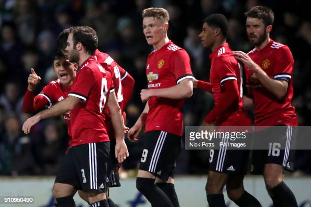 Manchester United's Alexis Sanchez speaks with teammates after Manchester United's Marcus Rashford scores his side's first goal of the game