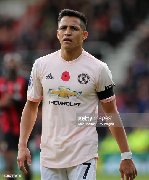 Manchester United's Alexis Sanchez wearing a black armband in memory of the victims of the Leicester helicopter crash which included Leicester...