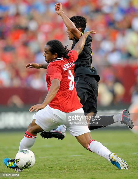Manchester United's Anderson left collides with BArcelona's Thiago right as Manchester United plays Barcelona in an exhibition game at FedEx Field in...