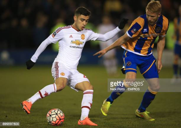 Manchester United's Andreas Pereira and Shrewsbury Town's Zak Whitbread battle for the ball