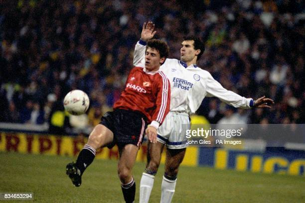 Manchester United's Andrei Kanchelskis holds off Tony Dorigo of Leeds United
