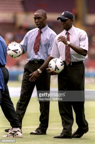Manchester United's Andy Cole and Dwight Yorke deep in conversation before the game