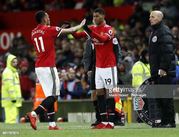 Manchester United's Anthony Martial is substituted off the pitch for Marcus Rashford during the Premier League match at Old Trafford Manchester