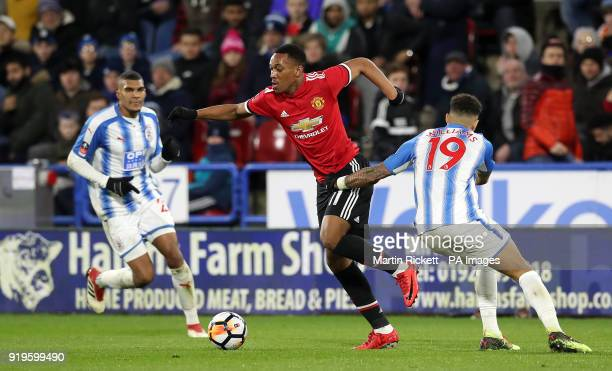 Manchester United's Anthony Martial skips away from Huddersfield Town's Danny Williams during the Emirates FA Cup Fifth Round match at The John...