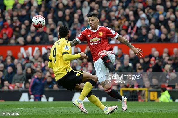 Manchester United's Argentinian defender Marcos Rojo and Aston Villa's English midfielder Scott Sinclair vie for the ball during the English Premier...