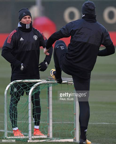 Manchester United's Argentinian defender Marcos Rojo and Manchester United's Swedish striker Zlatan Ibrahimovic attend a team training session at the...