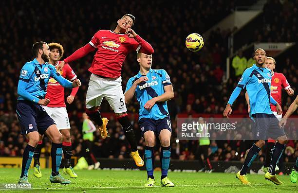Manchester United's Argentinian defender Marcos Rojo jumps to try to connect with Mata's freekick in the buildup to Manchester United's second goal...