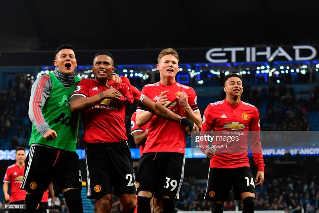 Manchester United's Argentinian defender Marcos Rojo, Manchester United's Ecuadorian midfielder Antonio Valencia, Manchester United's midfielder Scott McTominay and Manchester United's English midfielder Jesse Lingard celebrate victory after the final whistle in the English Premier League football match between Manchester City and Manchester United at the Etihad Stadium in Manchester, north west England, on April 7, 2018. / AFP PHOTO / Ben STANSALL / RESTRICTED TO EDITORIAL USE. No use with unauthorized audio, video, data, fixture lists, club/league logos or 'live' services. Online in-match use limited to 75 images, no video emulation. No use in betting, games or single club/league/player publications. /