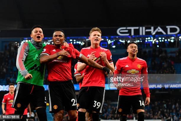 Manchester United's Argentinian defender Marcos Rojo Manchester United's Ecuadorian midfielder Antonio Valencia Manchester United's midfielder Scott...