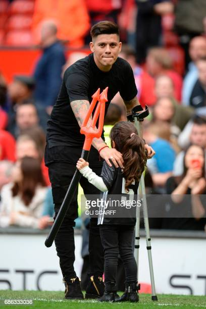 Manchester United's Argentinian defender Marcos Rojo stands on the touchline during the English Premier League football match between Manchester...