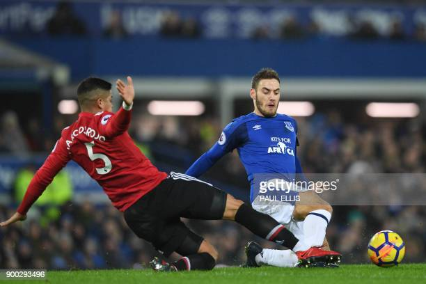Manchester United's Argentinian defender Marcos Rojo vies with Everton's Croatian striker Nikola Vlasic during the English Premier League football...