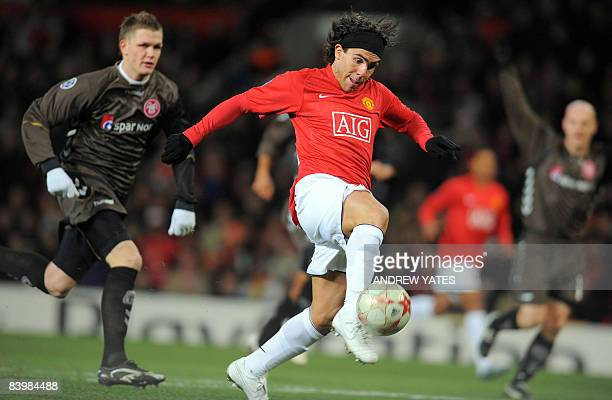 Manchester United's Argentinian forward Carlos Tévez scores the opening goal during the UEFA Champions league group E football match against Aalborg...