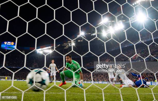 Manchester United's Argentinian goalkeeper Sergio Romero looks at the ball after Basel scored during the UEFA Champions League Group A football match...