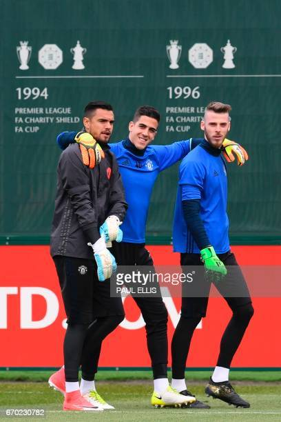 Manchester United's Argentinian goalkeeper Sergio Romero Manchester United's Swiss goalkeeper Joel Castro Pereira and Manchester United's Spanish...