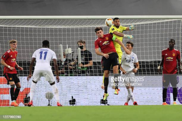 Manchester United's Argentinian goalkeeper Sergio Romero punches the ball next to the Manchester United's English defender Harry Maguire during the...