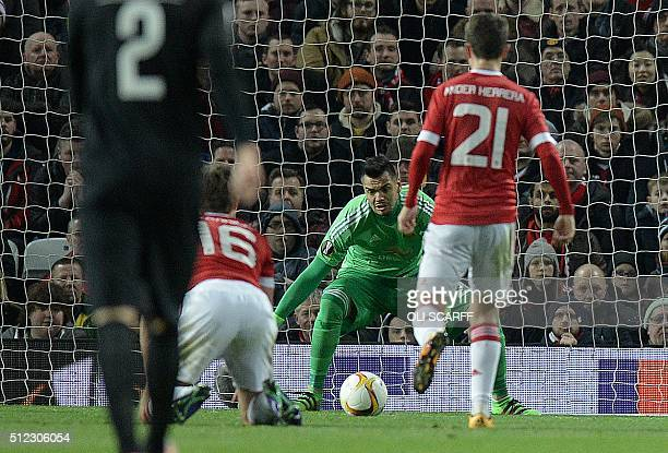 Manchester United's Argentinian goalkeeper Sergio Romero watches as a shot from FC Midtjylland's Ugandan forward Pione Sisto goes on to score the...