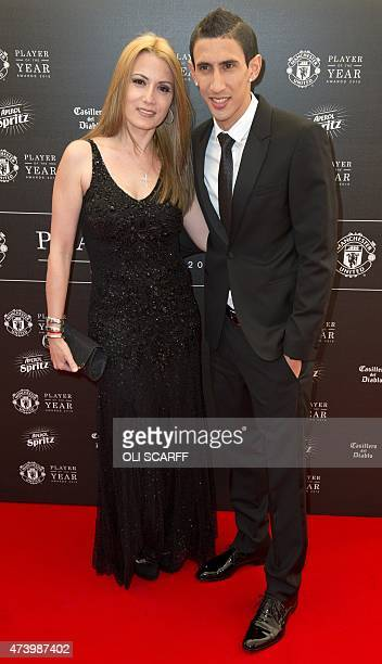 Manchester United's Argentinian midfielder Angel Di Maria and his wife Jorgelina pose for pictures on the red carpet as they arrive to attend the...
