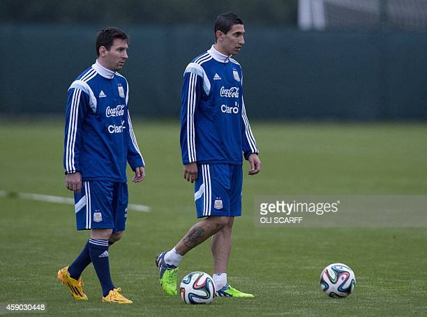 Manchester United's Argentinian midfielder Angel Di Maria and Barcelona's Argentinian striker Lionel Messi train with the Argentina national football...