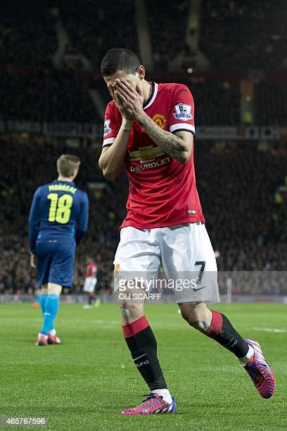 Manchester United's Argentinian midfielder Angel Di Maria reacts to a missed chance during the FA Cup quarterfinal football match between Manchester...